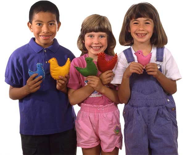 children holding felt birds made using the My First Sewing Book